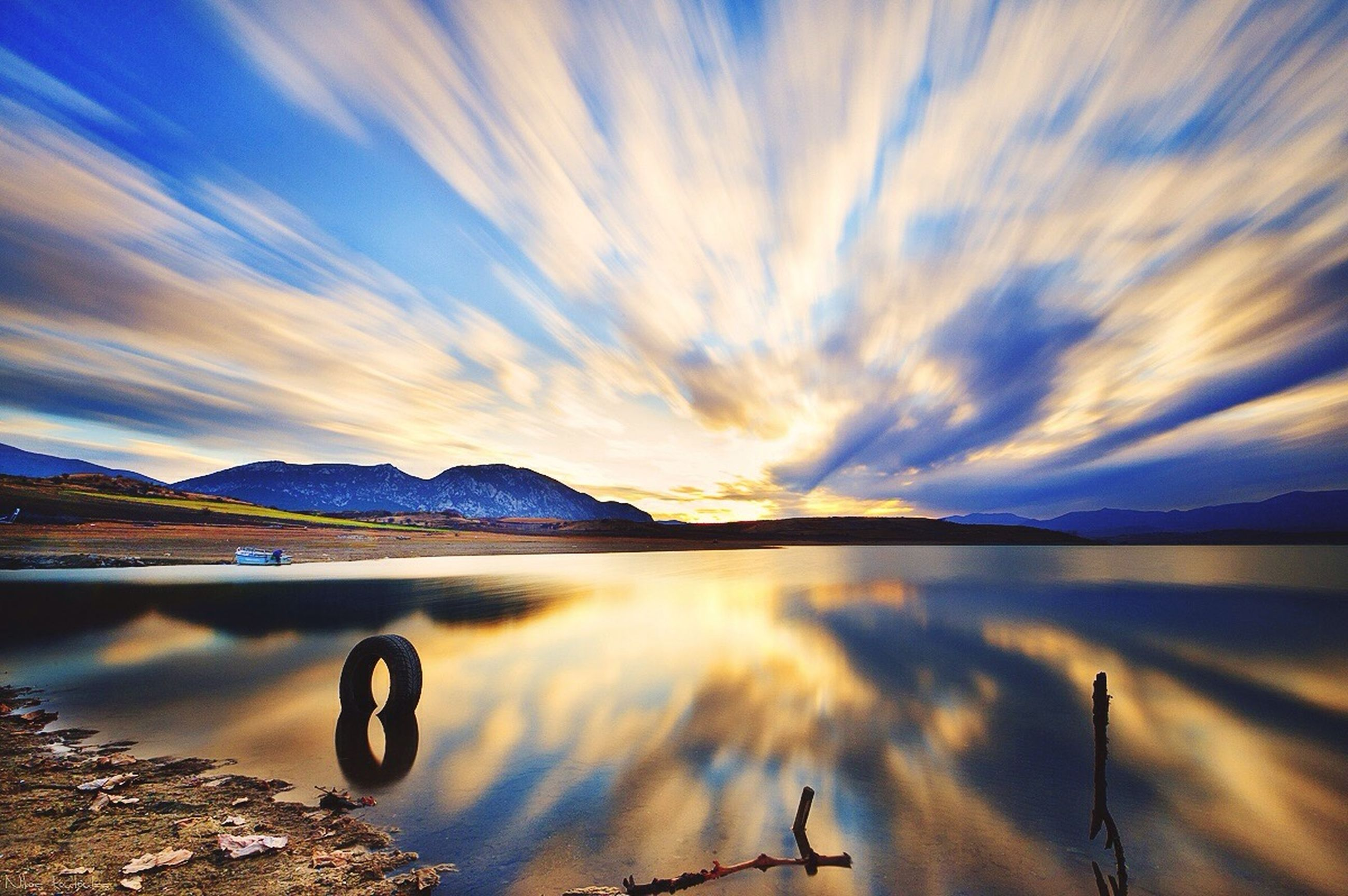 lake, water, sky, tranquil scene, tranquility, scenics, mountain, beauty in nature, cloud - sky, reflection, sunset, nature, mountain range, cloud, idyllic, cloudy, non-urban scene, lakeshore, calm, outdoors