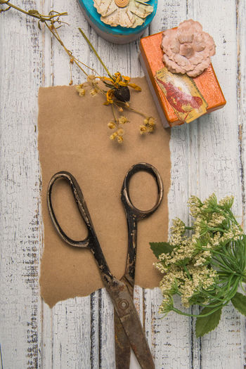 Blank brown paper with old scissors and decorated gift boxes Copy Space Rustic Scissors Background Blank Paper Brown Dried Flowers Flowers Gift Message Paper Present Rusty Shabby Chic Text Space Vintage