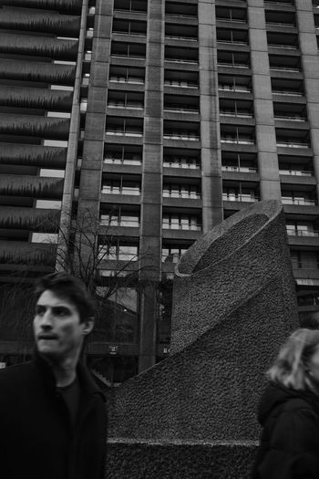 Barbican Street Photography Blackandwhite Black And White Moody London Passerby Strangers Street Men Building Urban Scene Architecture Built Structure Tower