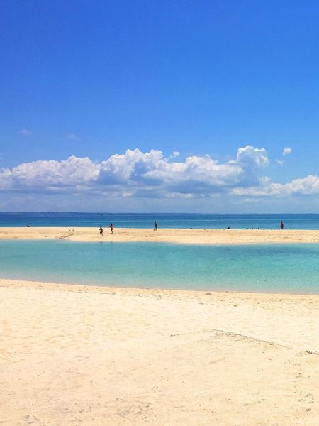 Beach Tropical Climate Sea Horizon Over Water Blue Sand Water Sky Scenics Nature Beauty In Nature Outdoors Day Cloud - Sky Vacations Tourism Travel Destinations