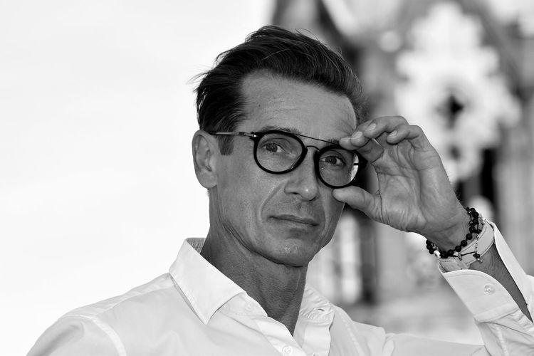 Portrait of man wearing eyeglasses standing outdoors