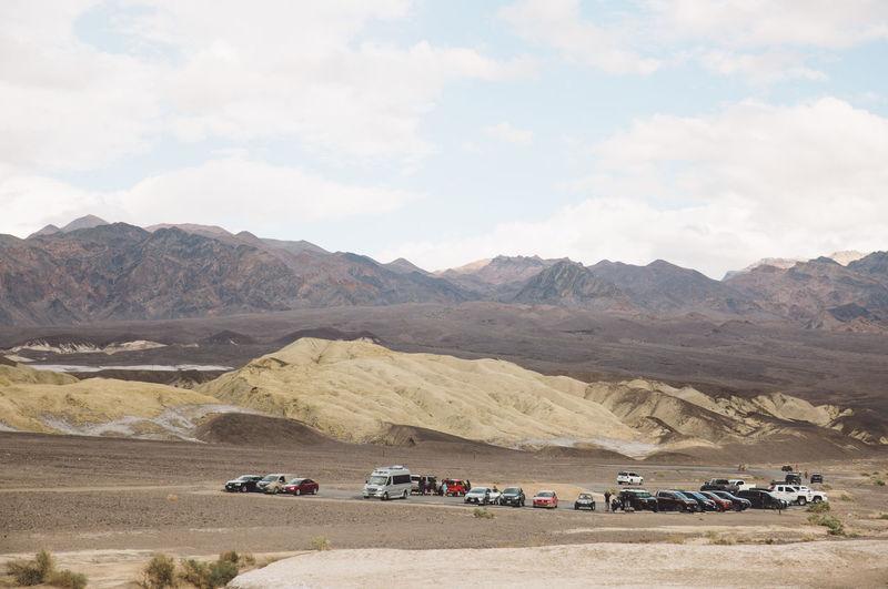Cars On Desert Against Sky