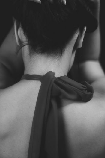 Rear view of woman with textile tied in neck