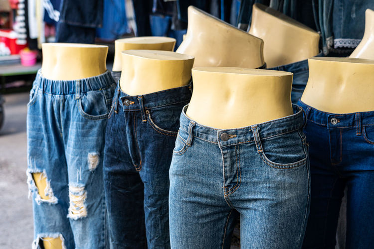 Clothes displayed on mannequins at shop