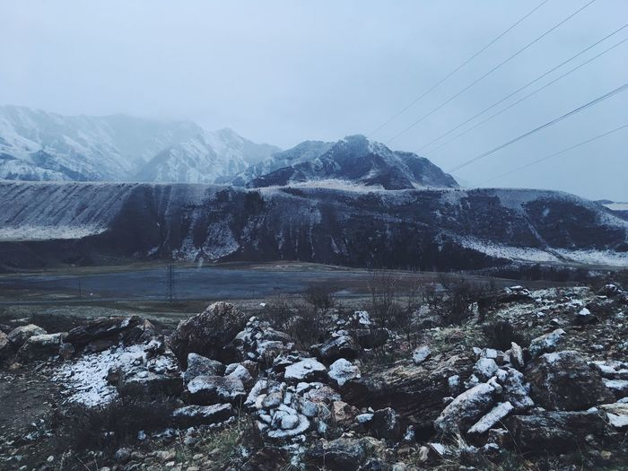 Scenic view of snowcapped mountains against sky. altay