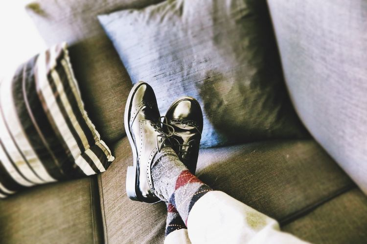 Business Couch Modern Relaxing Black Shoes Chic Close-up Day Extravagance Grey High Angle View Human Body Part Human Hand Human Leg In Indoors  Low Section Men One Person Pattern People Real People Shoe Shoes Women