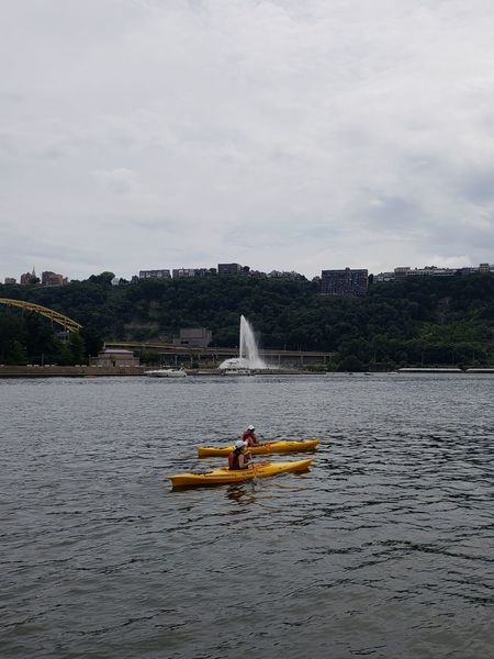 Kayaking Two People Pennsylvania Beauty Beauty In Nature Tranquil Scene Park Tranquility Business Finance And Industry Reflection Tourism City City Life Water Fountain Pennsylvania Pittsburgh Water Sky River Kayak Bridge Boat Paddling Life Jacket Rowing Chain Bridge Flowing Water The Great Outdoors - 2018 EyeEm Awards Idyllic Calm Scenics