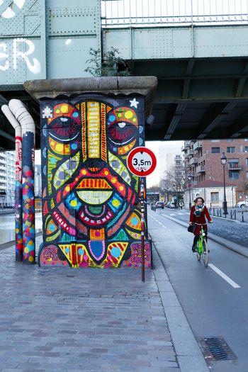 Man with bicycle on bridge