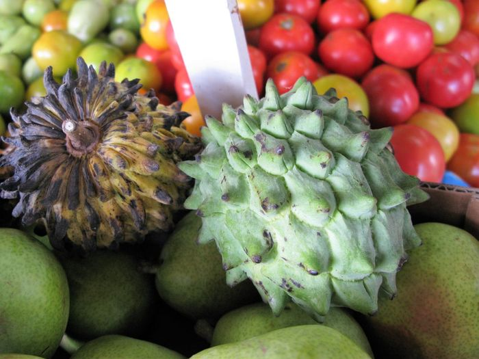 Close-Up Of Various Fruits For Sale In Market Stall