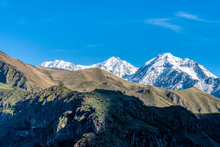 Snow-capped mountains in stepantsminda, aka kazbegi, georgia.