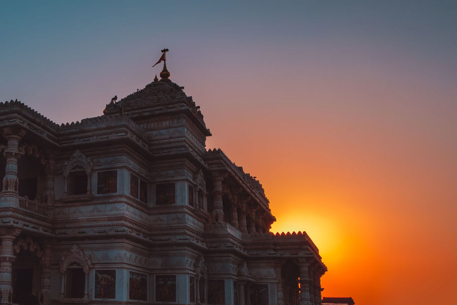 Sunset on the grounds of Prem Mandir in the sacred city of Mathura. It was one of the most beautiful sunsets I witnessed in India. Hazy and dreamy. The Past Sunset Architecture Built Structure Orange Color Building Exterior Travel Destinations History Travel Low Angle View Tourism No People Silhouette Belief Religion Building Spirituality Art And Craft Outdoors Hazy Sunset Religious Sites Hinduism Old Structures India Old Architecture
