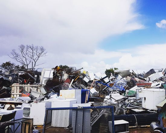Consumerism Capitalism Dumpster Dump TIP White Goods Decay HUMANITY Anthropocene Climate Change Global Warming Environmental Issues Waste Management Waste Trash Rubbish Tree Day Outdoors No People Sky Cloud - Sky