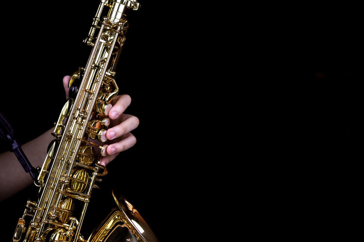 Music Instrument Alto Saxophone Player, Saxophone Player Isolated on black Musical Instrument Music Arts Culture And Entertainment Real People Skill  Human Hand One Person Holding Musician Artist Saxophone Playing Human Body Part Hand Men Performance Copy Space Occupation Musical Equipment Finger Black Background