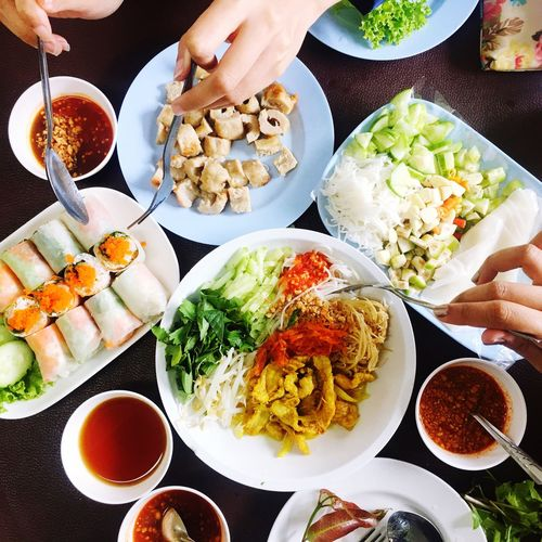 Cropped image of hands with food at table