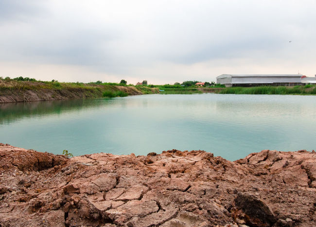 Pure aqua basin with red cracked dirt Aqua Basin Beauty In Nature Blue Colour Of Life Dirt Lake Landscape Laterite Nature Pool Pure Red Reflection Refreshment Reservoir Ripples Scenics Shine Surface Texture