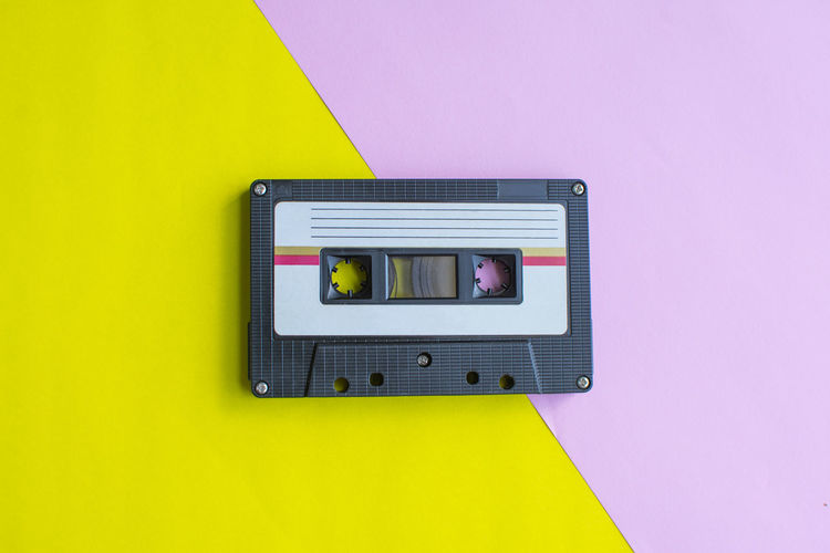 Tape Cassette Old Vintage Retro Yellow Technology Wall - Building Feature No People Indoors  Close-up Pink Color Copy Space Connection Electricity  Colored Background Communication Music Architecture Multi Colored Studio Shot Protection Control Still Life Power Supply