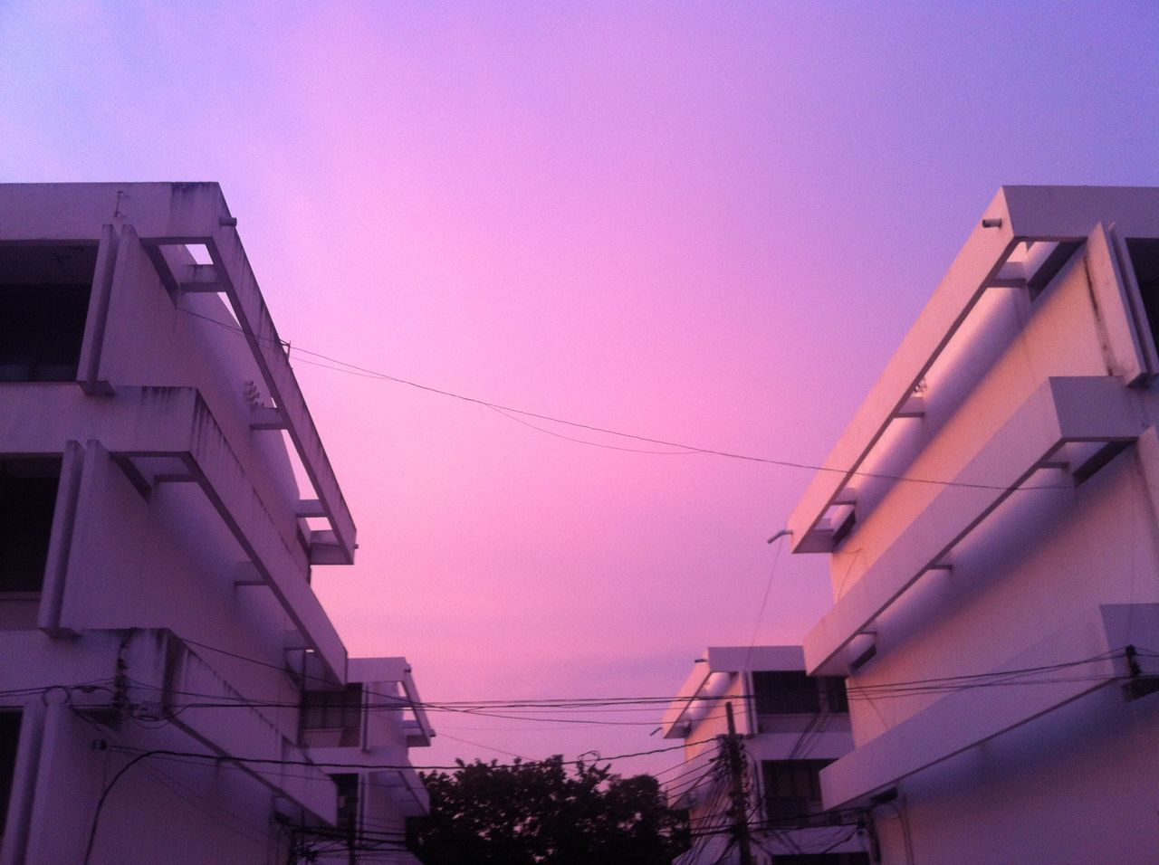 low angle view, no people, built structure, clear sky, cable, architecture, sunset, outdoors, building exterior, sky, day, nature