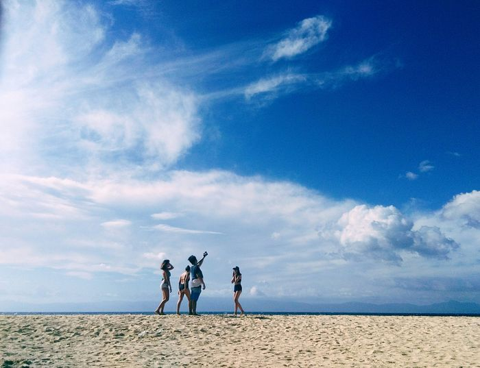 Young, Wild and Free. #MissingD'goodOldDays Nature Horizon Over Water Sky Background Capture The Moment Summer Sunny Blue Sky Sky And Clouds Getaway  Philippines Cebu Beach Blue Togetherness Friendship Sea Sand Standing Walking