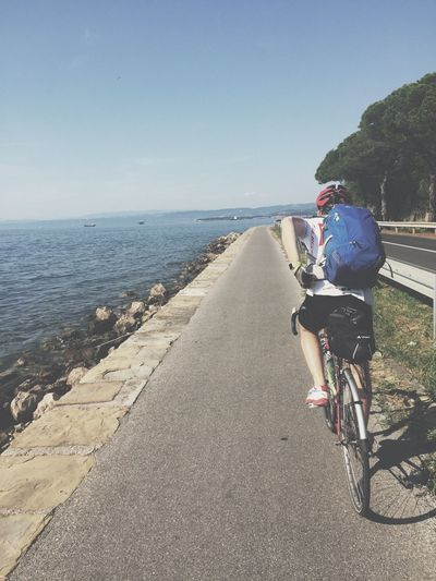 Bike Trip On The Road Next To The Sea Enjoying The View From Vienna To Milan