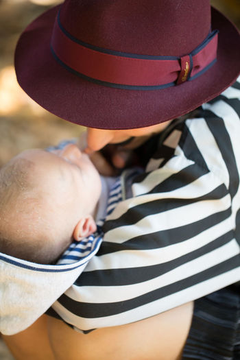 Baby Fashion Stories Hat Close-up Day Leisure Activity Lifestyles One Person Outdoors Real People Standing Striped Women