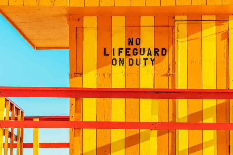 No Lifeguard on duty #2 Built Structure Communication Architecture Text Yellow No People Sign Day Western Script Building Exterior Outdoors Security Safety Full Frame Number Non-western Script Nature Sunlight Blue Pattern Miami South Beach USA Lifeguard