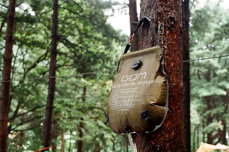 Camping Shower Minolta Monolta X300 Gom Camping Life Camp Outdoors Film Photography Film Filmcamera Birdhouse Tree Day Nature No People Hanging Solar Power