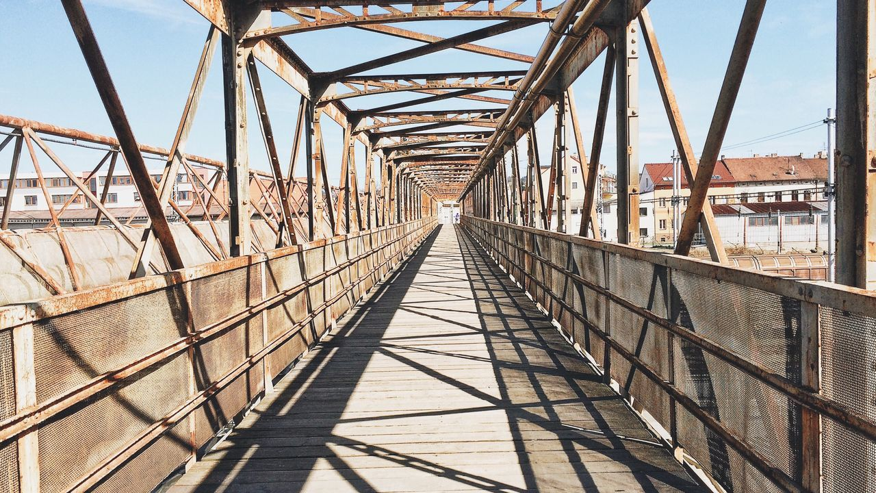 bridge, bridge - man made structure, built structure, architecture, connection, the way forward, transportation, direction, nature, diminishing perspective, railing, sky, sunlight, shadow, day, metal, engineering, footbridge, outdoors, iron - metal, steel, long, girder