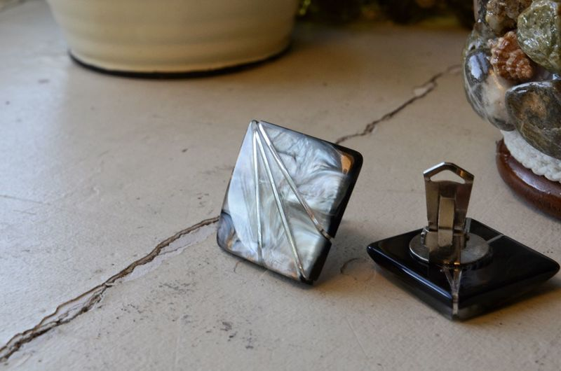 High angle view of cuff links on table