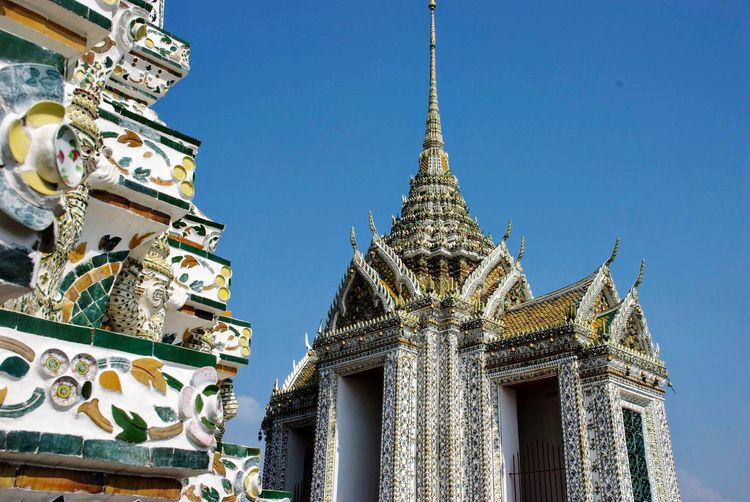 Decoration and ornaments on towers of buddhist temple wat arun in bangkok, thailand