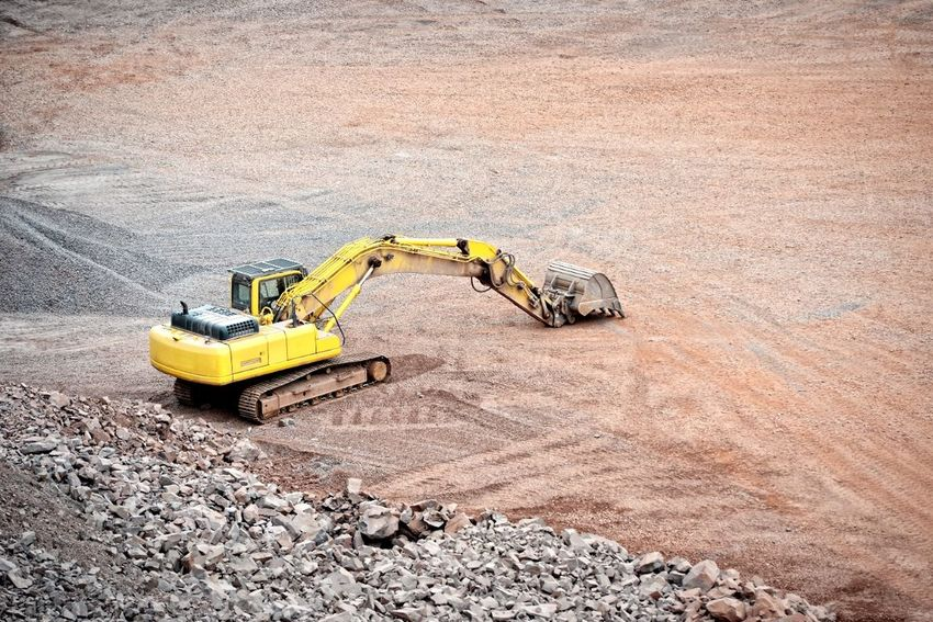 earth mover in a quarry. open pit mine. mining industry Mine Construction Material Pit Schottersteine Construction Quarry Open Pit Mine Mining Stones Porphyry Bergbau Excuvator Steinbruch RocksBagger