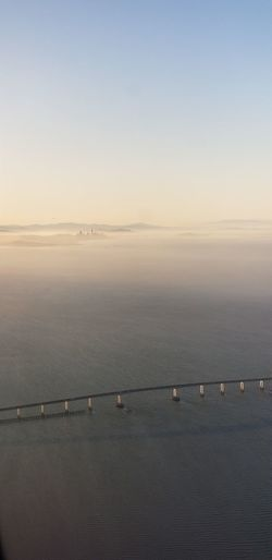 aerial view of San Francisco and the Bay at sunset Foggy Sunset View From The Top Sunny Bridge - Man Made Structure Springtime No Filter Purist No Edit No Filter San Francisco Skyline Blue Sky And Clouds Water Sunset Blue Sunlight Suspension Bridge