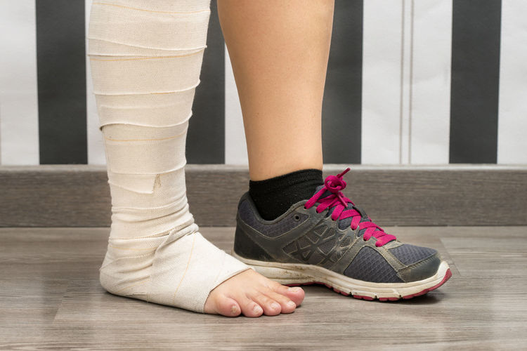 Injured woman Injured Close-up Human Body Part Human Leg Indoors  Low Section One Person People Shoe Sport Standing