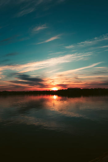 Beauty In Nature Tranquility Sunset Tranquil Scene Water Sky Cloud - Sky Scenics - Nature No People Idyllic Waterfront Nature Reflection Orange Color Non-urban Scene Sea Outdoors Dramatic Sky EyeEm Nature Lover
