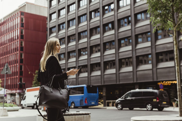 Woman standing on street in city