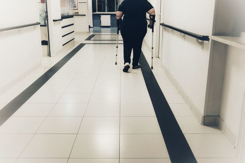 patient with crutches in the hospital Care Hospital Nurse Obesity Walk Corridor Crutches Disabled Hospital Life One Person Patient Rehabilitation Terapy Walking