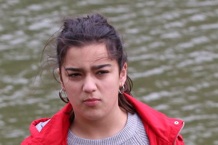 Teenage girl by lake