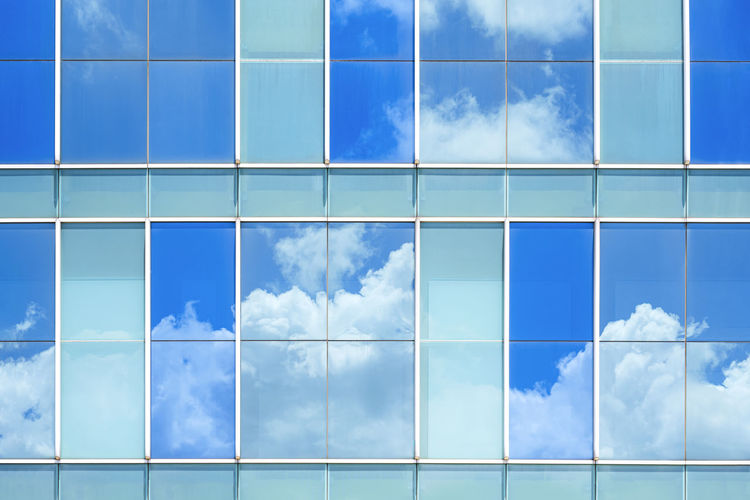 Low angle view of blue sky seen through glass window