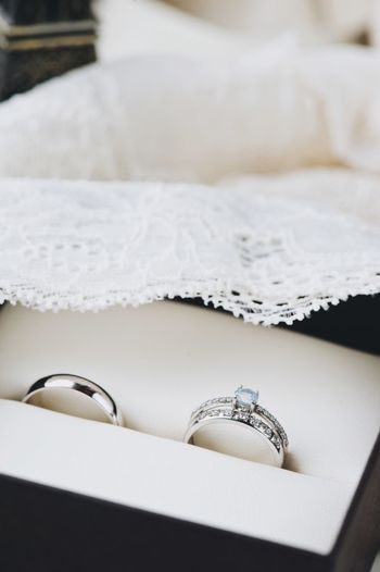 close-up wedding rings Jewelry Indoors  White Color Close-up Still Life Diamond - Gemstone Ring Home Interior Celebration Necklace Luxury Metal Selective Focus No People Focus On Foreground Wealth Furniture Publication Bed Domestic Room