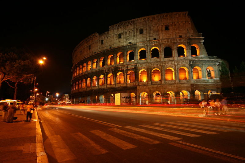 Ancient Architecture Building Exterior Built Structure City Colosseum History Illuminated Light Trail Long Exposure Motion Night No People Outdoors Road Sky Speed Street Tourism Travel Travel Destinations