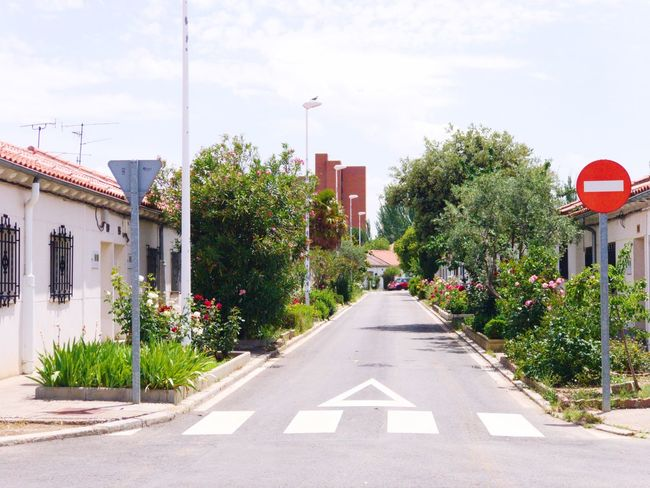Architecture Street Road Outdoors No People Town Road Sign Building Exterior Growth City Nature Urban Garden Urban Gardening Streetphotography Cityscape Urban Lifestyle Garden Photography Urban Landscape Architecture_collection Salamanca Garden The Way Forward Road Architecture Built Structure