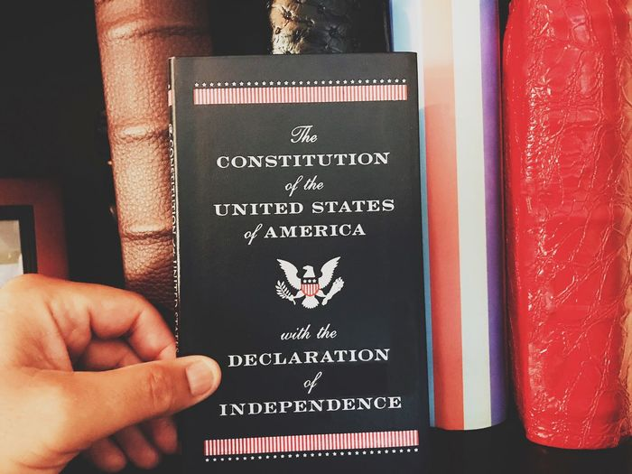 Government Rights Activism Body Part Close-up Communication Constitution Declaration Declarationofindepenance Finger Hand Holding Human Body Part Human Hand Information Law Non-western Script One Person Passport Personal Perspective Real People Script Sign Text Western Script