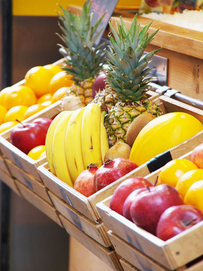 Close-up of fruits in wooden basket
