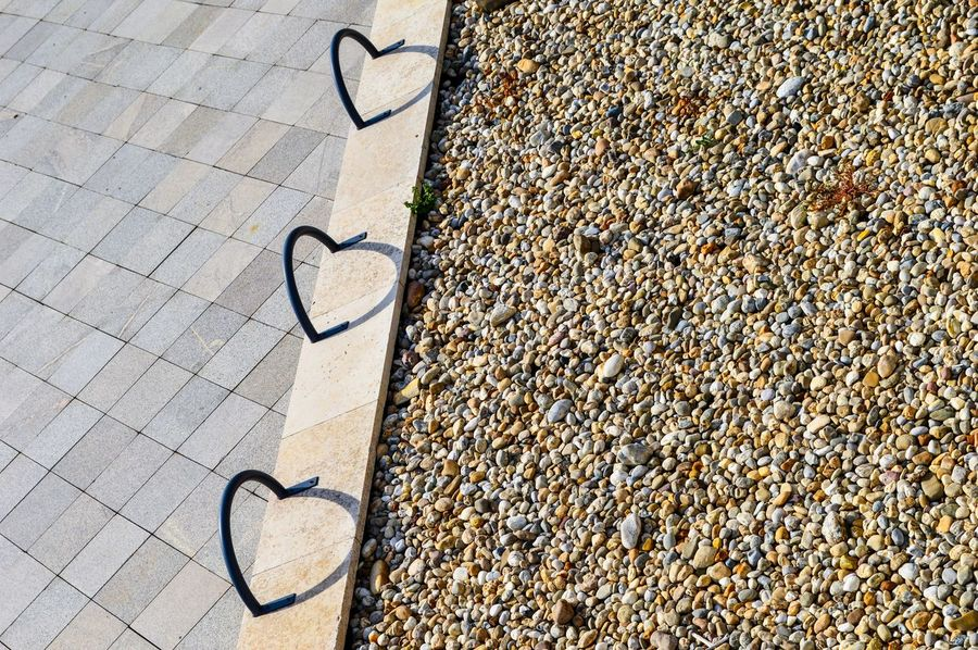 Shapes Pattern Pattern, Texture, Shape And Form Street Geometry Geometric Shape Simplicity Abstract Light And Shadow Shadow Shadowplay High Angle View Close-up Heart Shape Focus On Shadow Long Shadow - Shadow Pair Things That Go Together Street Scene Pavement Pebble Sidewalk