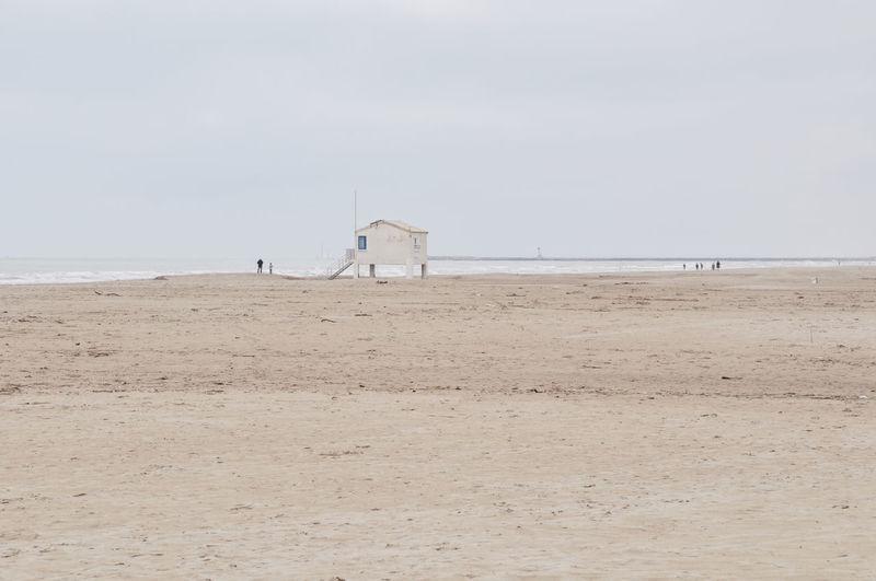 View of calm beach against clear sky