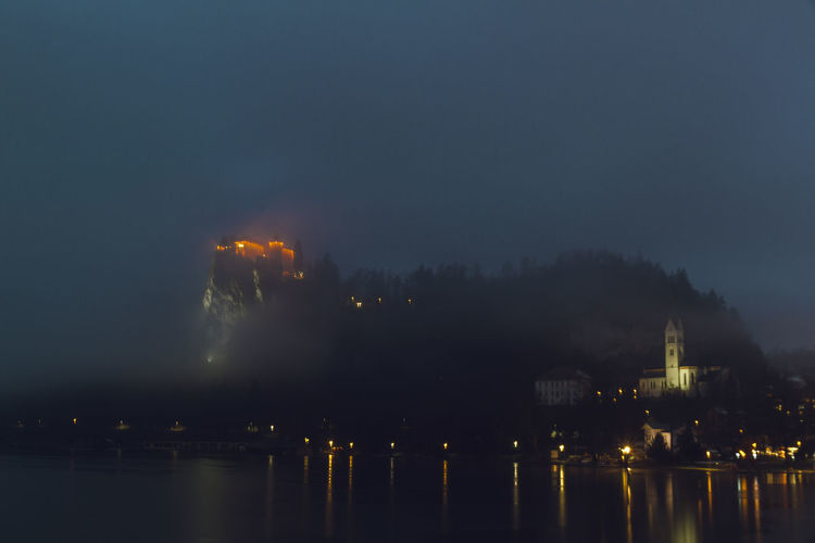 Castle Church Architecture Built Structure Churches Clouds Factory Illuminated Mist Nature Night No People Outdoors Sky Water