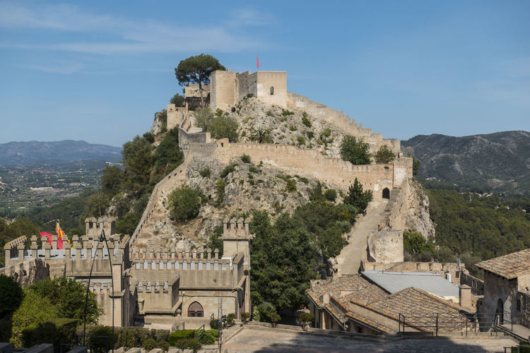 Castle Ancient Ancient Civilization Archaeology Architecture Blue Sky Building Building Exterior Built Structure Day History Mountain Nature No People Old Outdoors Plant Sky The Past Tourism Travel Travel Destinations Tree Xativa Xativa's Castle