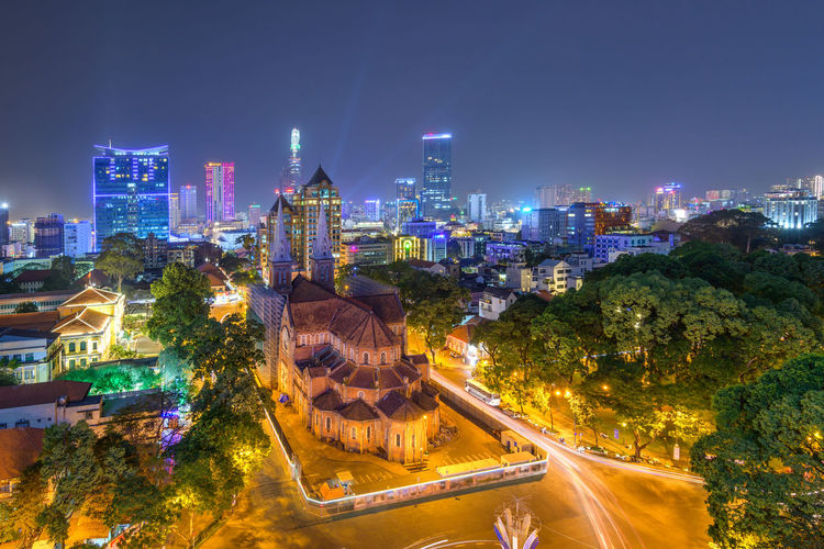 Cityscape in Vietnam Church God Vietnam Architecture Building Building Exterior Built Structure City City Life Cityscape Financial District  Glowing Illuminated Landscape Long Exposure Modern Nature Night No People Office Building Exterior Outdoors Religion Sky Skyscraper Travel Destinations