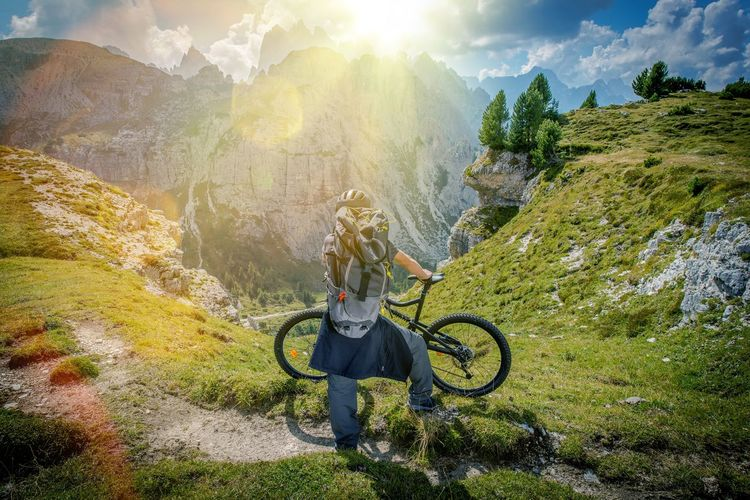 Man With Bicycle On Mountain