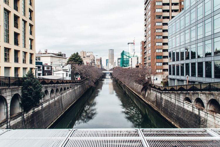 River water reflected buildings in tokyo, japan in wintertime