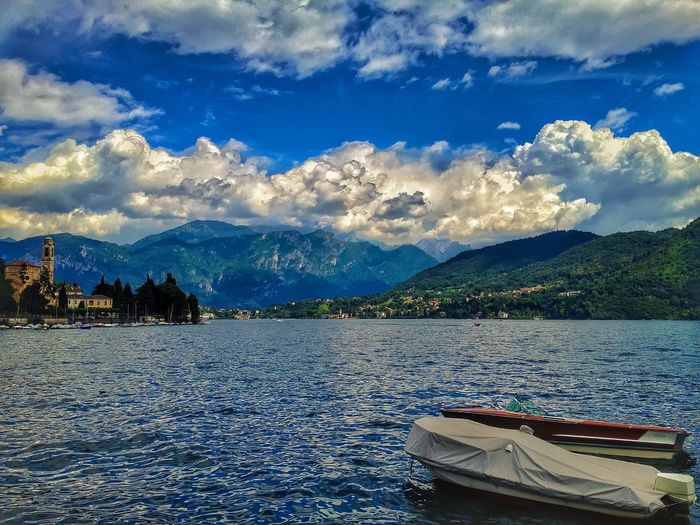 Nautical Vessel Transportation Boat Mode Of Transport Water Mountain Mountain Range Sky Waterfront Blue Cloud - Sky Tranquility Tranquil Scene Scenics Nature Day Non-urban Scene Sea Outdoors Beauty In Nature